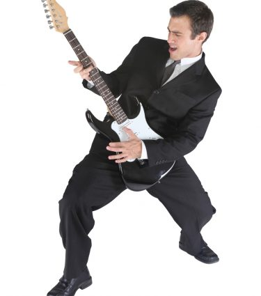 Businessman rocking out with guitar